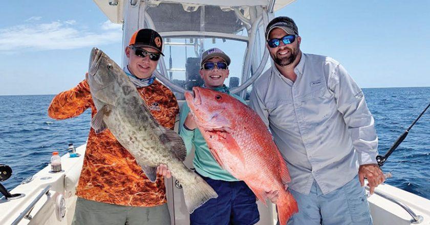 Parker Gillman, Landon Celona & Brian Beighey loading the boat.