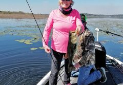 Rhonda Hastings holding up a nice 3-lber caught on another very tough windy day.