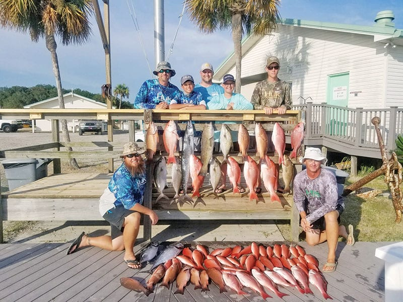 The Sawyer family with a great haul aboard the Kitchen Pass.