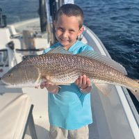 The kids are all smiles when fishing with Capt. Garrison and Reel Rosie Charters.