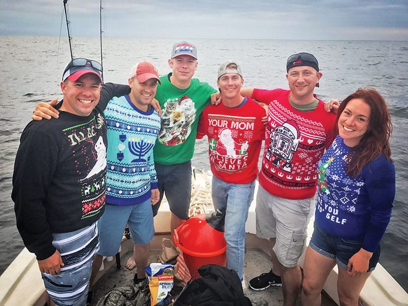 This Massachusetts National Guard unit fishing aboard the Kitchen Pass in their ugly Christmas Sweaters.