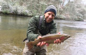 A nice Toccoa River delayed harvest rainbow with a snowy March background