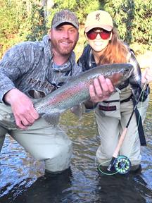 Amanda McLendon & Bryan Farley landing a trophy rainbow trout at Noontootla Creek Farms
