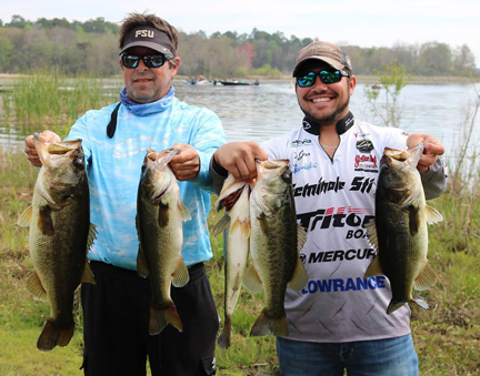 Paul Tyre and Nic Jeter with their winning catch in the Fishers of Men tournament