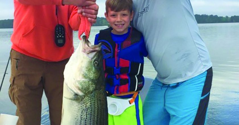 G C Lewis of Newnan, Ga brings his 8-year-old out for first time and young Lewis boats a 35 pounder