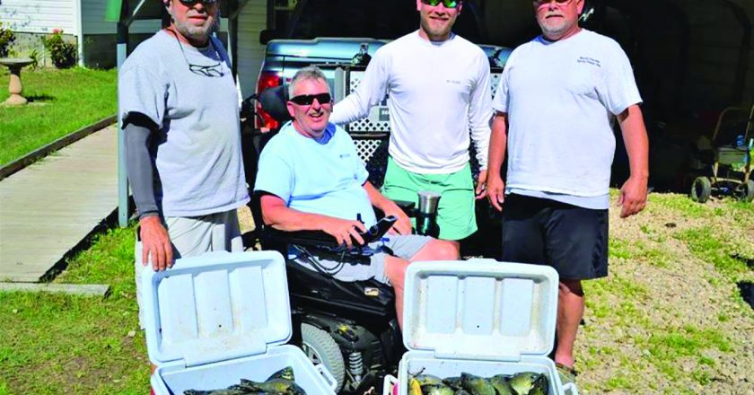 Paul Tyre, Angelo Koundourakis, Brandon and Neal Autry from Woodville, FL with a day's catch of Seminole shellcrackers