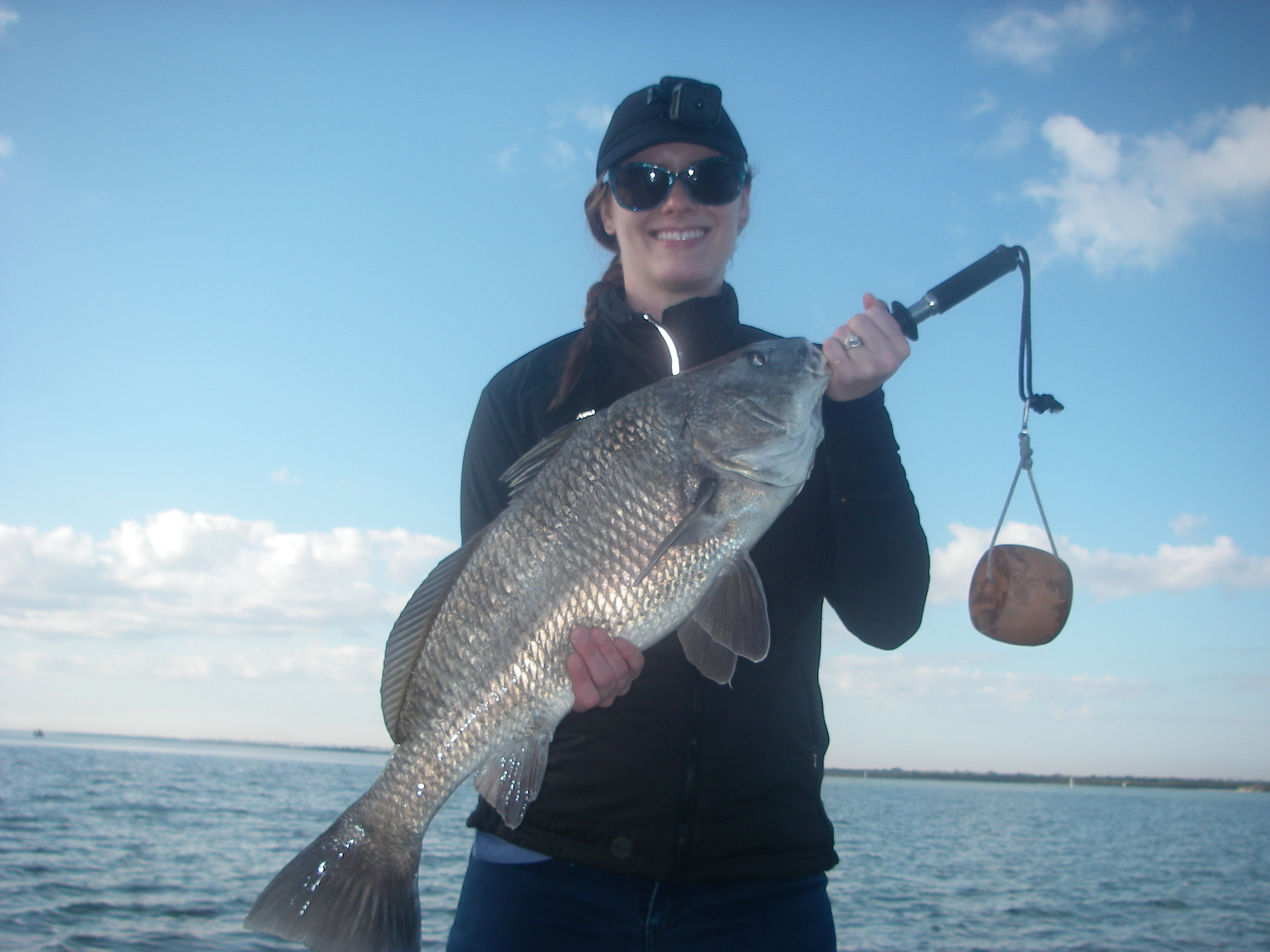 Sarah is all smiles after doing battle with this black for Murphy s hook house fishing report
