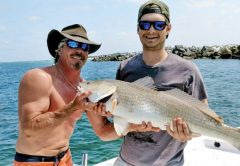 Bryan Ferns and Tim Morris of Panama City with a nice redfish aboard The Gun Show.