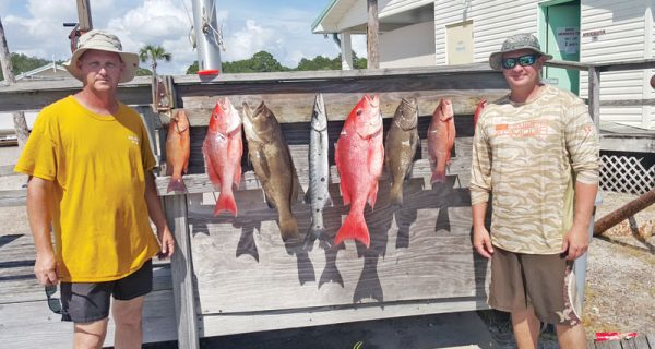 Capt. Tew and Tony Fiorenza with a nice haul aboard the Kitchen Pass.