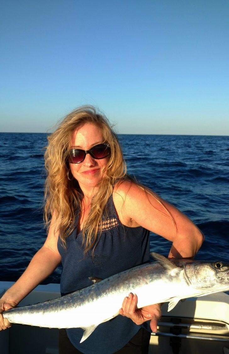 Lady angler Faith caught this 15lb King while fishing with her husband about two miles offshore Hollywood Beach, FL.