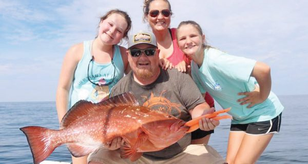 Blake family with a nice red grouper on the Adrenaline boat.