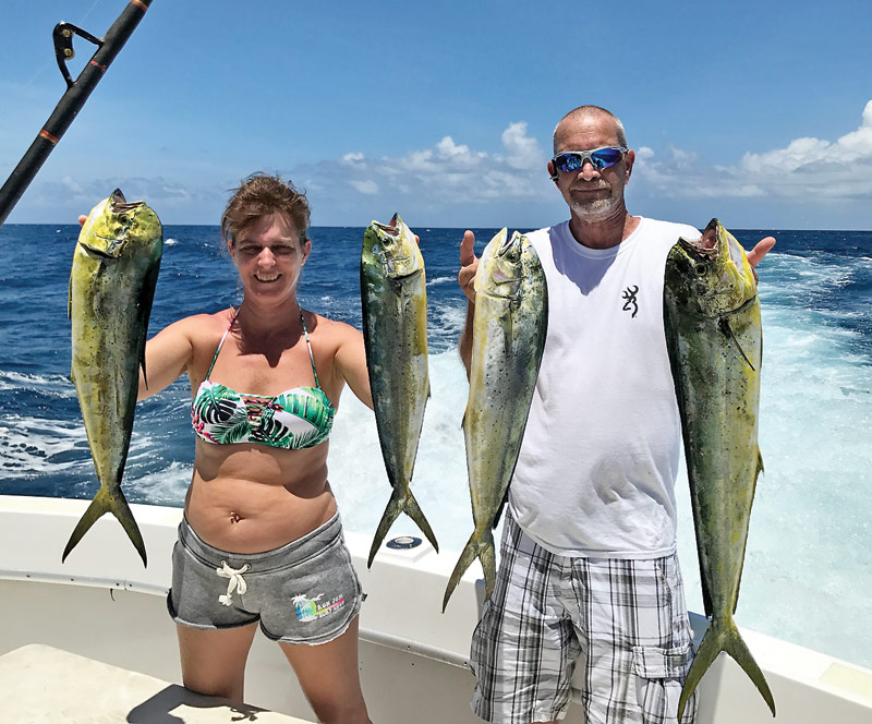 Chaylene with a nice catch of dolphin fishing with New Lattitude Sportfishing.