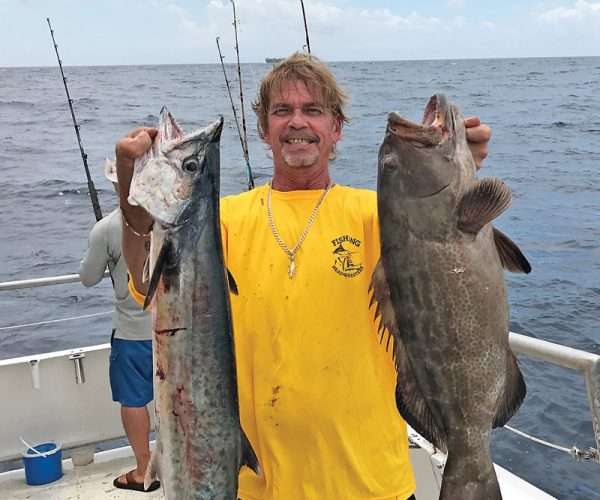 Greg with a nice kingfish and grouper caught aboard Catch My Drift.