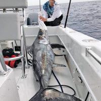Sarah with a nice swordfish caught with New Lattitude Swordfishing.