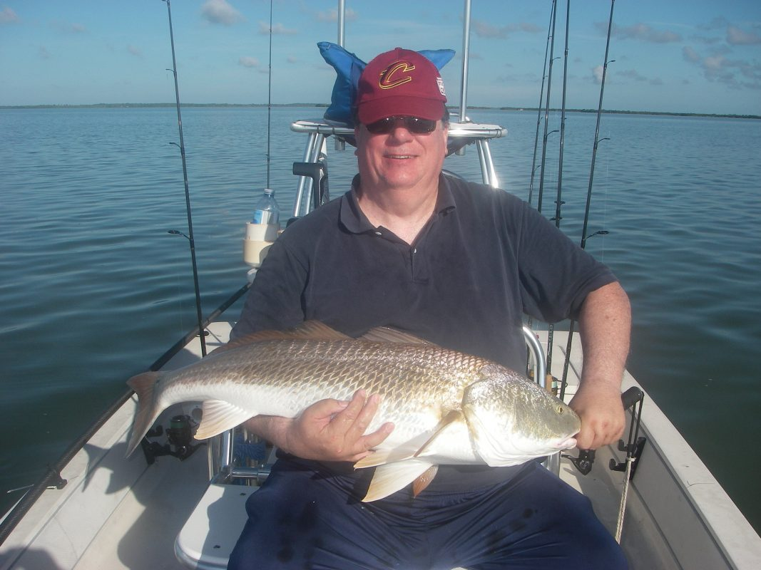 Ed caught a personal best redfish recently with Capt. Mark Wright. He plucked this breeder out of a group of fifty fish as they actively fed on schooling mullet!