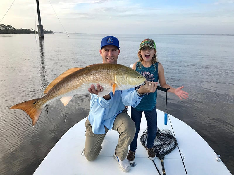 Jerad Merbitz and daughter Liana with their redfish on the NIRL.