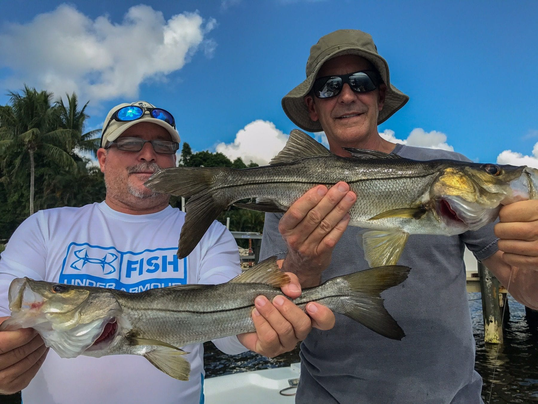 Robert and his long time buddy double up on snook for Bob fish west bend