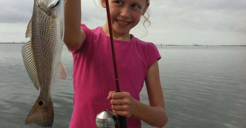 Madison Ellis with her first redfish