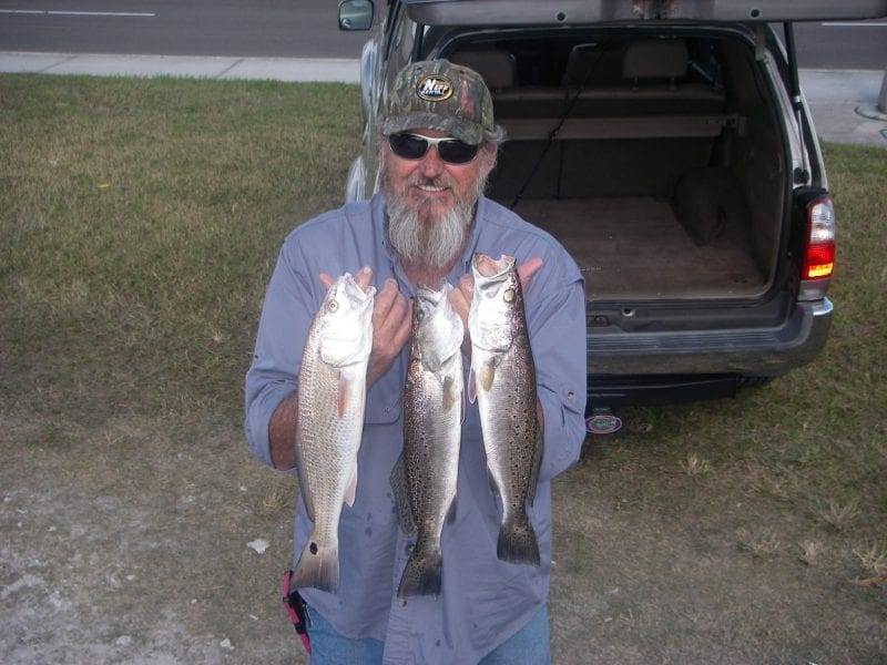 "Frank gave the trout a real spanking on a recent trip with Capt. Mark Wright. Getting the timing right on the ""warm-up"" resulted in well over a two man limit on upper slot trout and several redfish!"