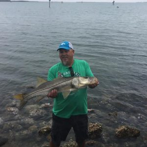 Joe Sheaffer w/ a nice snook, quickly getting her back in the water, Placida pier