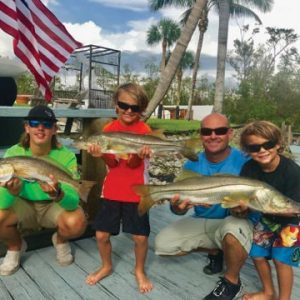 Kingston and Carson with their first keeper snooks caught on Capt. Redfish Rob's Charters in Naples, FL