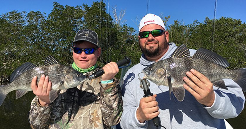 "Charlie ""the fish slayer"" and his dad Chuck, with a beautiful pair of black drum."