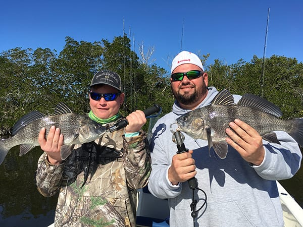 """Charlie """"the fish slayer"""" and his dad Chuck, with a beautiful pair of black drum."""