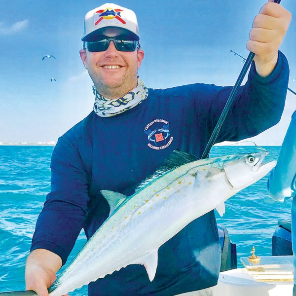 Happy angler with a Spanish mackerel caught aboard Bouncer's Dusky 33.