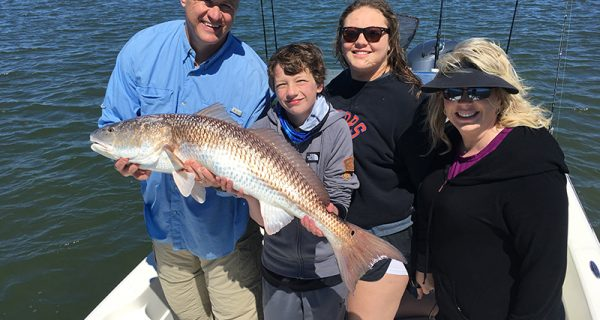 Redfish like this one caught by Greg Spurling and family used to be common catches in the Banana River Lagoon, but constant lawn fertilization and raw sewage dumping is killing this unique body of water.