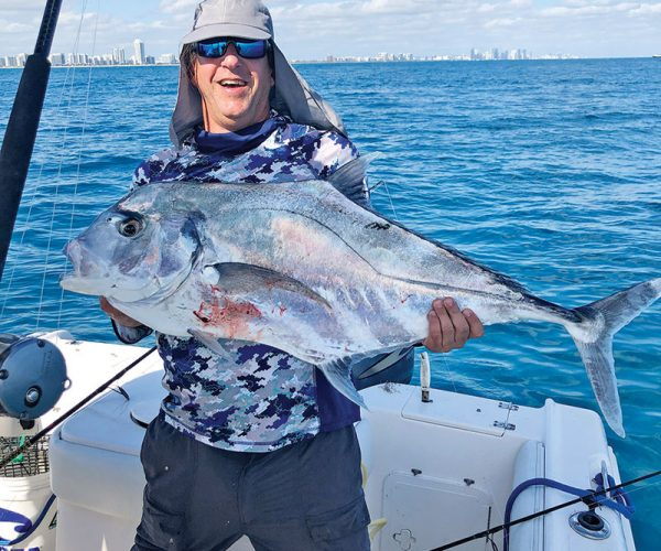 Hector Martinez with an African pompano caught off Miami Beach on a live sardine.