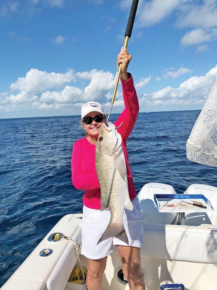 Sally Stribling slayed a slob of a mangrove snapper drifting a live ballyhoo off Key Largo.