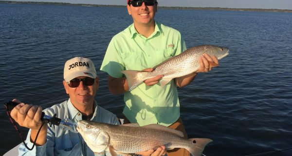 Redfish like this pair that hit live free-lined shrimp, may be possible on the shallow flats if the waters stay relatively clear and baitfish are present.
