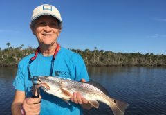 Debbie Smith's redfish hit a Saltwater Assassin 4-inch sea shad in the Natural glow color.