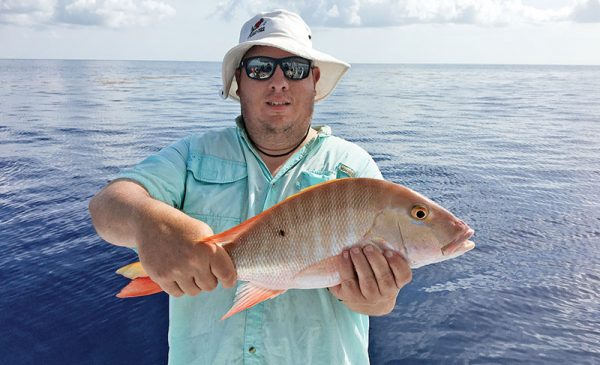 Glen with a nice mutton snapper caught with Fishing Headquarters.