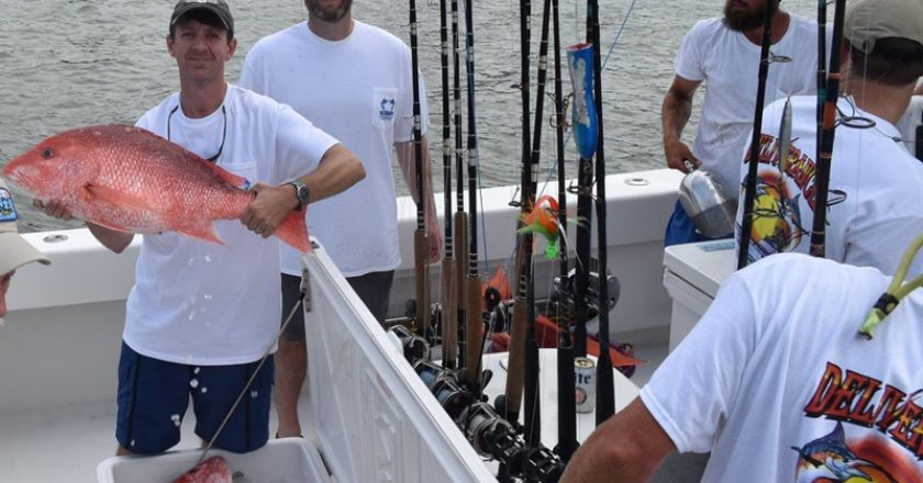 Team Deliverance showing off heir catch of Red Snapper at the Alabama Deep Sea Fishing Rodeo.