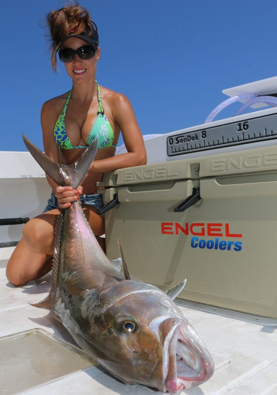 Luiza shows off a nice Amberjack. For more information on this amazing lady angler, go to:  www.fishingwithluiza.com