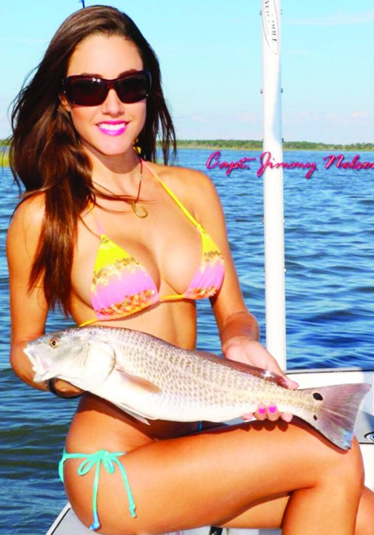 Luiza shows off a nice Redfish. For more information on this amazing lady angler, go to: www.fishingwithluiza.com