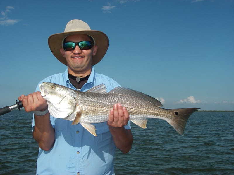 Jacob gets a top-slot redfish using chunk mullet strategically placed on the end of a sandbar which was covered up in live mullet!
