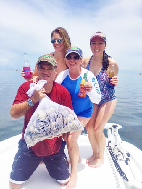Good friends and clients from Tampa, Greg Polk and his wife Sabrina, along with daughter Kayla left and friend Kayla on the right, taking a short break with some of their harvest while out with Captain Rick Burns.
