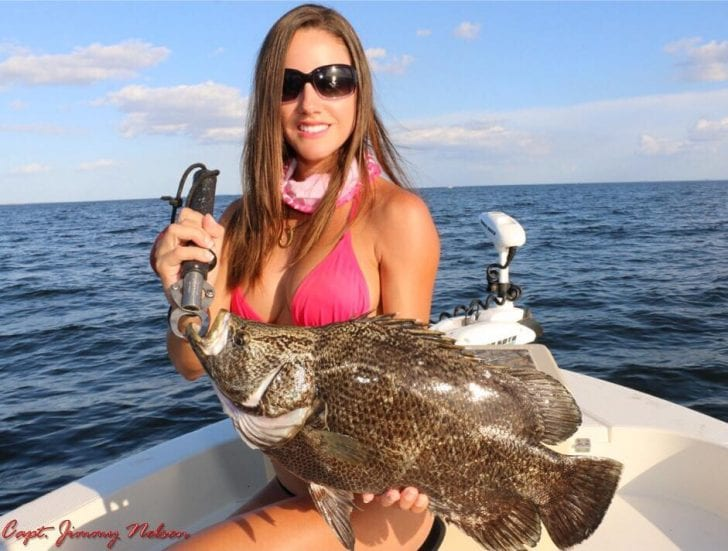 Luiza shows off a nice Tripletail. Learn more about this amazing lady angler:  www.fishingwithluiza.com