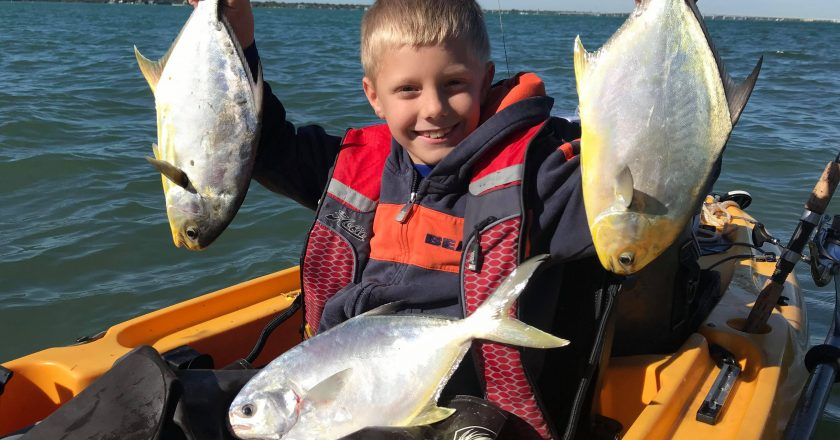 Braden Nelli with his first couple of pompano.