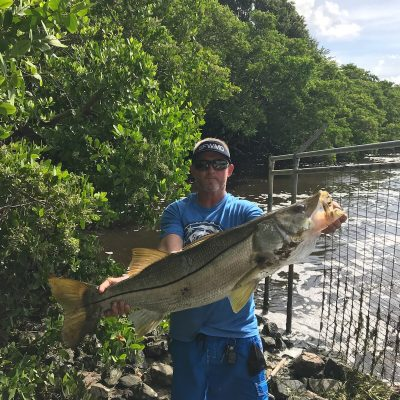 Neil McConnell at Lake Worth Spillway with 46 inch 32 lbs snook