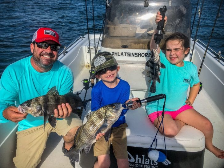 Ryan, Ryker and Ocean holding up black drum.