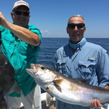 Paul Caruso and Chappy show off their catch this past season while fishing with Underdog Charters.