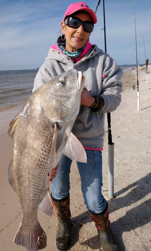 Colleen Rhyde, from upstate NY, Caught this 30 lb. Redfish in mid-December at Fort Morgan.
