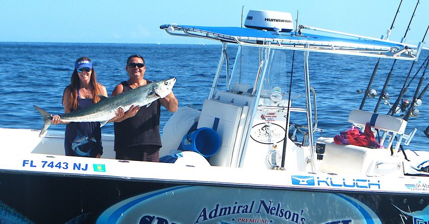 Billy and Sheri with her kingfish landed late on a Sunday afternoon