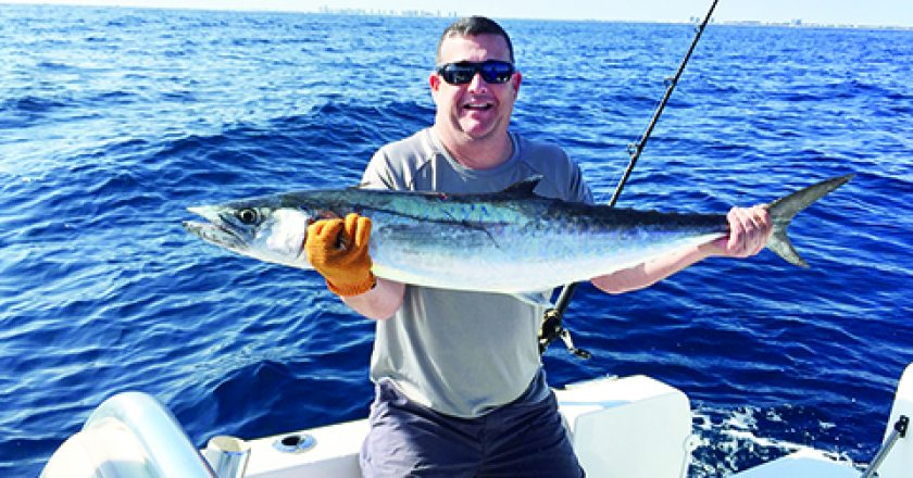man on boat with kingfish