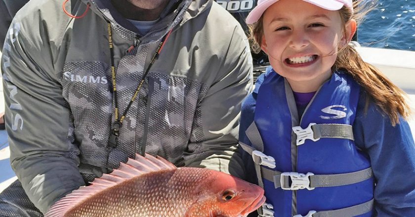 Capt. Lionel James getting kids hooked on fishing.